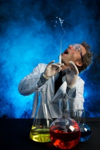 A scientist shoots a stream of water into the air from a syringe.